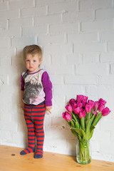 happy child with tulips