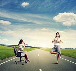 displeased woman and smiley yoga woman