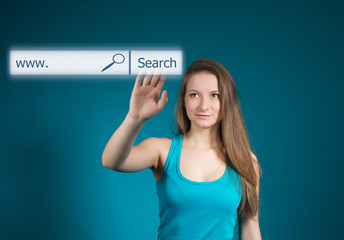 Young woman pointing at search bar on virtual screen.