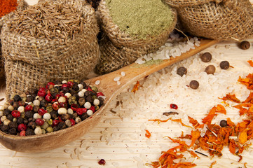 spices with rice on a wooden surface