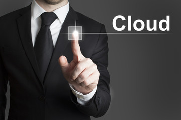 businessman pressing virtual button cloud