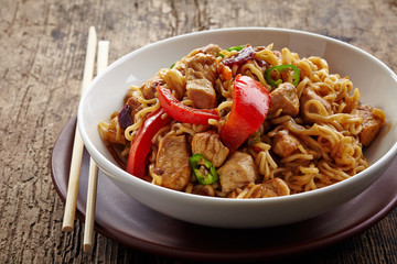 bowl of noodles with chicken and vegetables