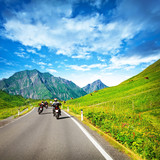 Motocyclists on countryside in mountains