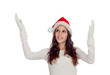 Attractive casual girl with Christmas hat extending her arms