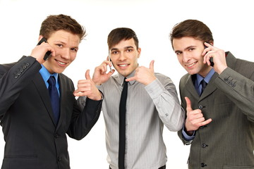 Three young men talks at mobile phone and shows you – call us