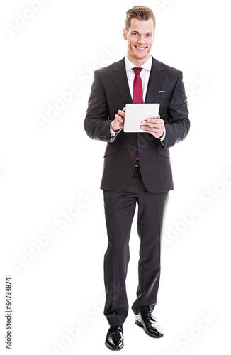 Geschäftsmann benutzt Tablet-PC - 64734874