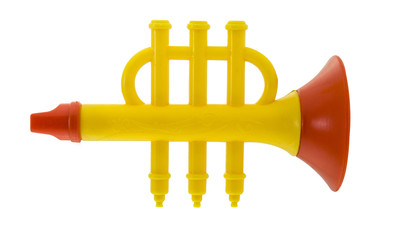 Plastic toy flute on white background