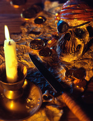 Pirate theme with skull, knife, treasure map and gold coins.