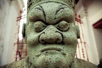 Stone Guard Statue at Wat Arun - Bangkok Thailand