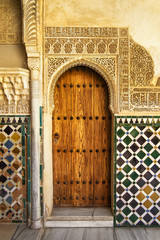 A door decorated in arabic style in La Alhambra, Granada, Spain
