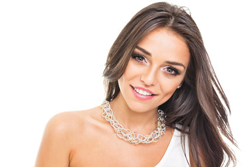 Gorgeous young woman with necklace smiling