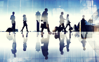 Group of Business Travellers Walking in the Airport