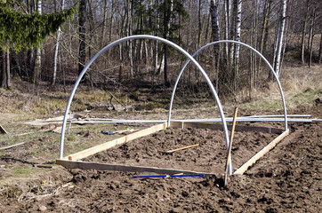beginning new plastic greenhouse construction frame