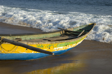 wooden fishing boat on bengal sea bay beach in Tamilnadu, India