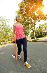 skateboarder walking