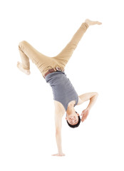 Young man dancing a breakdance and handstand pose