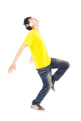 happy man dancing while listening music