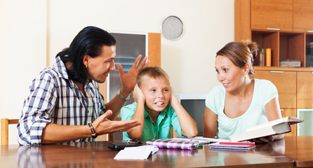 Parents scolds teenage son for bad study
