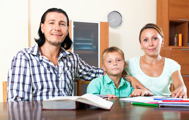 Parents and son doing homework