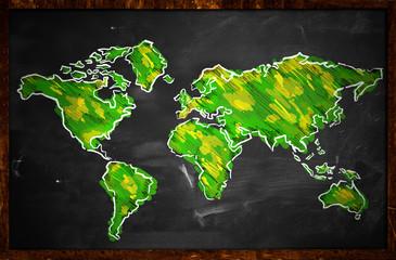 Green World Map Sketch On Blackboard