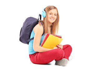 Beautiful female student with backpack
