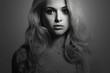 Monochrome Fashion portrait of young beautiful woman.Blond girl