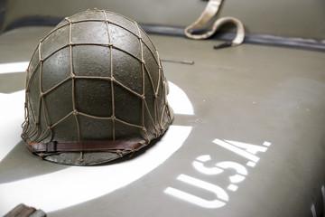 military helmet on the hood of military vehicle