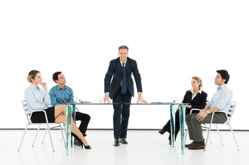 Manager With Colleague In Business Meeting