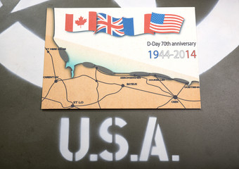 commemorative card of D-Day on the hood of a military vehicle