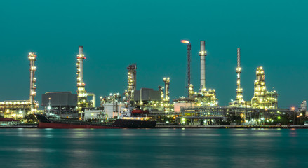 Oil refinery plant illuminated in green background
