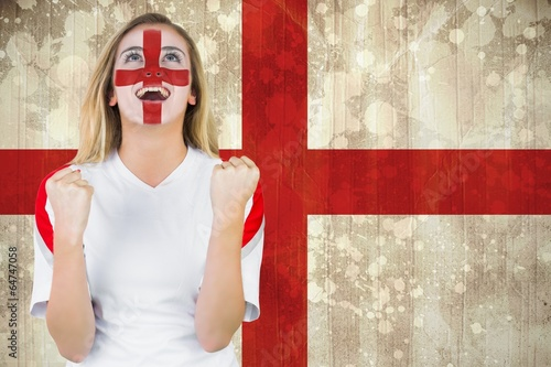 Leinwanddruck Bild Excited fan england in face paint cheering