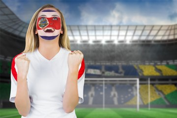 Excited costa rica fan in face paint cheering