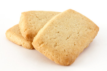 Butter biscuits in a stack on a white surface.