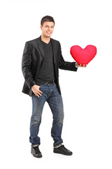 Romantic young man holding a red heart