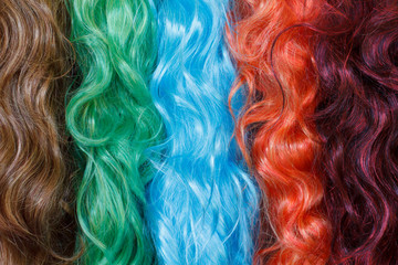 Coloured wigs with long wavy fake hair