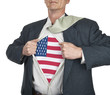 Businessman showing USA flag superhero suit underneath his shirt