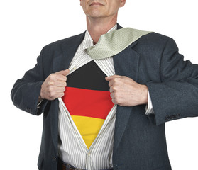 Businessman showing Germany flag superhero suit underneath his s