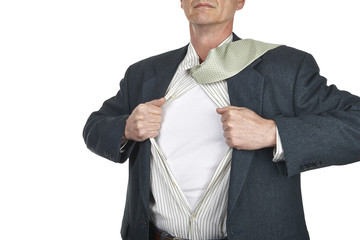 Businessman showing blank superhero suit underneath his shirt st