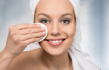 Happy attractive women removing makeup