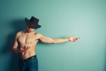Sexy shirtless cowboy pointing