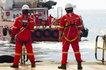 Rig workers and a standby boat