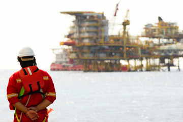 Rig worker and an oil platform