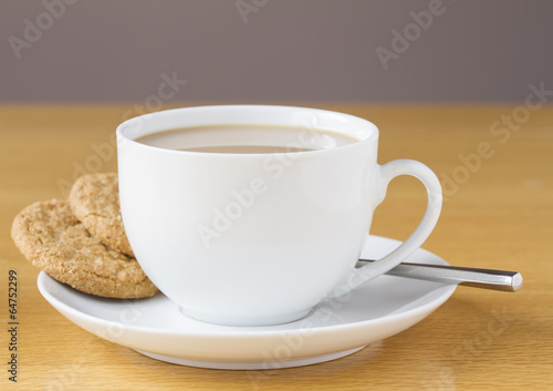Foto op Canvas Thee Cup of tea with two cookies