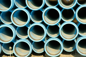 Stack of blue pipes