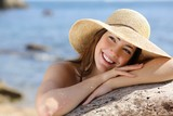 Fototapety Happy woman with white smile looking sideways on vacations