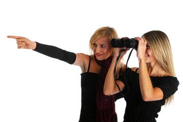 Two nice girls watching something with a binocular