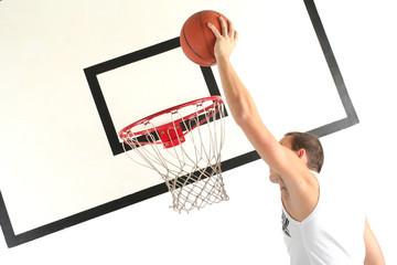 Young man playing basketball