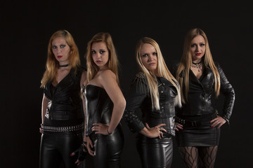 Group of young women wearing leather outfits