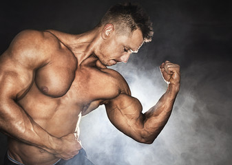 Bodybuilder with strong biceps