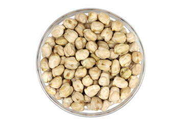 The dried chickpeas in a glass on a white background